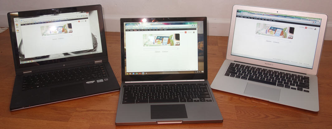 Google Pixel (center) flanked by MacBook Air and Lenovo Yoga. Photo by Larry Magid