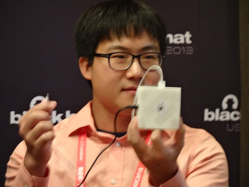 Security researcher Yeongjin Jang shows off rogue iOS charger (Photo: Larry Magid)